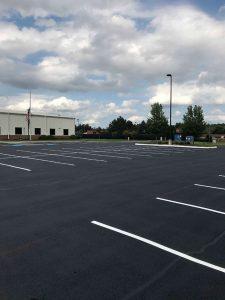 Sand additives on a resealed parking lot